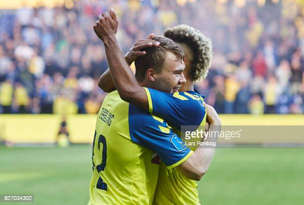 Simon Tibbling and Hany Mukhtar of Brondby IF celebrate after scoring their first goal during the Danish Alka Superliga match between Brondby IF and...