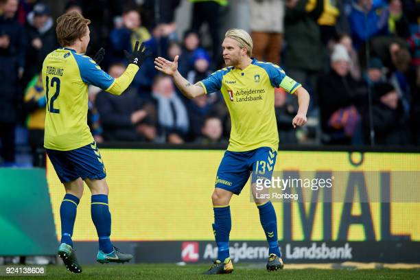 Simon Tibbling and Johan Larsson of Brondby IF celebrate after scoring their second goal during the Danish Alka Superliga match between Brondby IF...