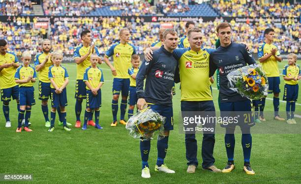 Simon Tibbling and Lasse Vigen Christensen of Brondby IF receiving flowers prior to the Danish Alka Superliga match between Brondby IF and Lyngby BK...