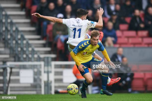 Simon Tibbling of Brondby IF and Andrija Pavlovic of FC Copenhagen compete for the ball during the Danish Alka Superliga match between FC Copenhagen...