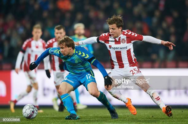 Simon Tibbling of Brondby IF and Frederik Borsting of AaB Aalborg compete for the ball during the Danish Alka Superliga match between AaB Aalborg and...