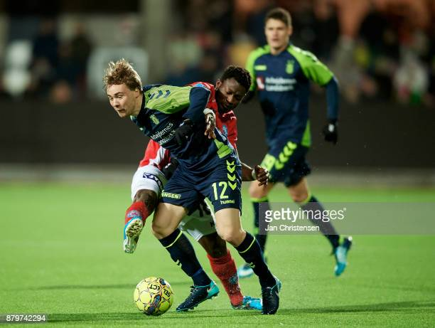 Simon Tibbling of Brondby IF and Ibrahim Moro of Silkeborg IF compete for the ball during the Danish Alka Superliga match between Silkeborg IF and...