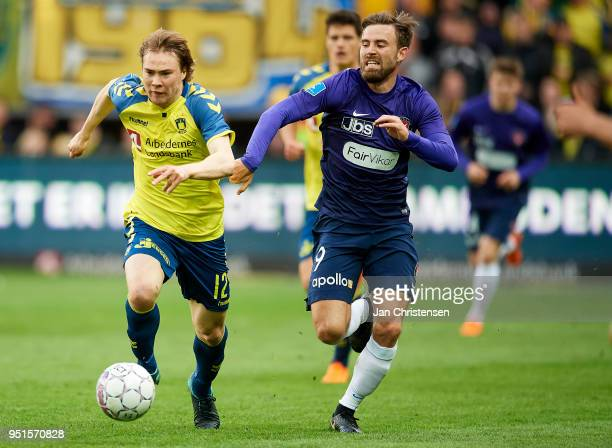 Simon Tibbling of Brondby IF and Janus Drachmann of FC Midtjylland compete for the ball during the Danish DBU Pokalen Cup Semifinal match between...