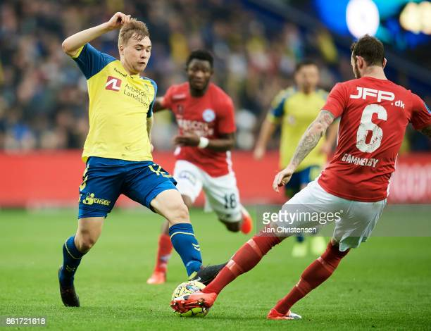 Simon Tibbling of Brondby IF and Jens Martin Gammelby of Silkeborg IF compete for the ball during the Danish Alka Superliga match between Brondby IF...