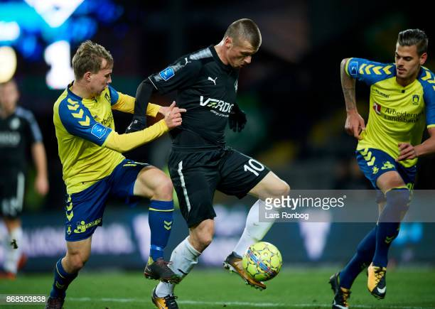 Simon Tibbling of Brondby IF and Marvin Pourie of Randers FC compete for the ball during the Danish Alka Superliga match between Brondby IF and...