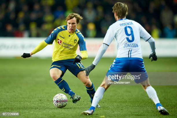Simon Tibbling of Brondby IF and Rasmus Jönsson of OB Odense compete for the ball during the Danish Alka Superliga match between Brondby IF and OB...