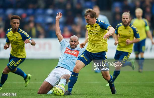Simon Tibbling of Brondby IF and Simon Poulsen of Sonderjyske compete for the ball during the Danish Alka Superliga match between Brondby IF and...