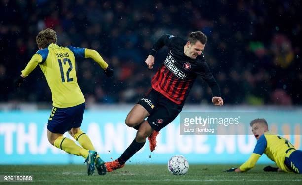 Simon Tibbling of Brondby IF and Zsolt Korcsmar of FC Midtjylland compete for the ball during the Danish Alka Superliga match between FC Midtjylland...