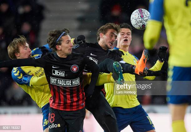 Simon Tibbling of Brondby IF Gustav Wikheim of FC Midtjylland Jakob Poulsen of FC Midtjylland and Christian Norgaard of Brondby IF compete for the...