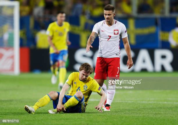 Simon Tibbling of Sweden injured after a duel during the UEFA U21 match between Poland and Sweden at Arena Lublin on June 19 2017 in Lublin Poland