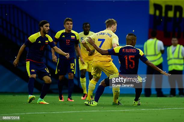 Simon Tibbling player of Sweden battles for the ball with Wilmar Barrios player of Colombia during 2016 Summer Olympics match between Colombia and...
