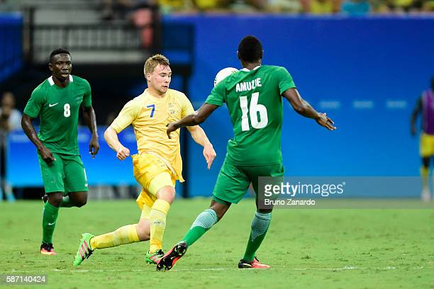 Simon Tibbling player of Sweden competes for the ball with Stanley Amuzie player of Nigeria during 2016 Summer Olympics match between Sweden and...