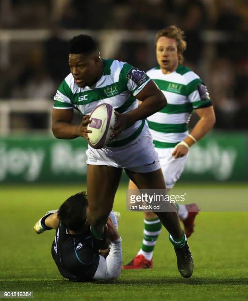 Simon Uzokwe of Newcastle Falcons is tackled by Aleksei Mikhaltsov of EniseiSTM during the European Rugby Challenge Cup match between Newcastle...