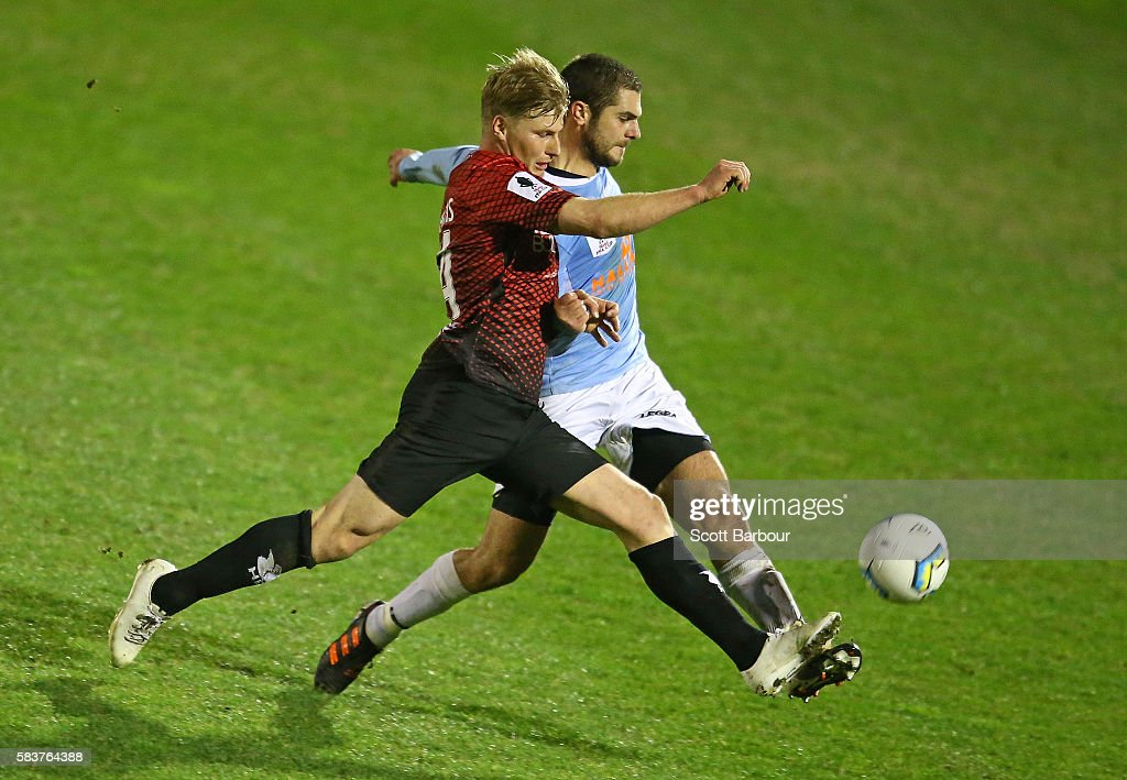 Simon Valastro of Marconi Stallions and Kym Harris of Hume City compete for the ball during the FFA Cup round of 32 match between Hume City and Marconi Stallions at ABD Stadium on July 27, 2016 in Melbourne, Australia.
