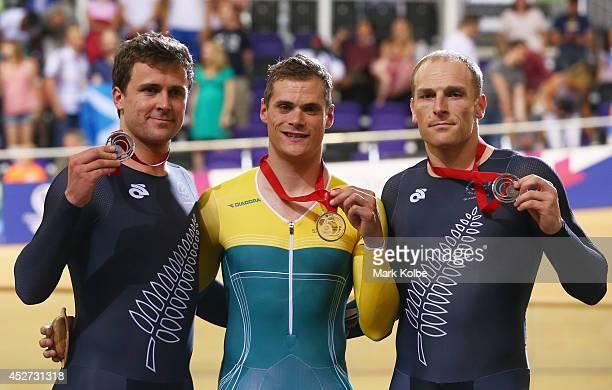 Simon van Velthooven of New Zealand gold medalist Scott Sunderland of Australia and bronze medalist Matthew Archibald of New Zealand celebrate on the...