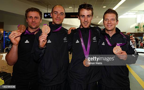 Simon van Velthooven Westley Gough Marc Ryan and Aaron Gate of the New Zealand Olympic Cycling team display their medals after arriving at Auckland...