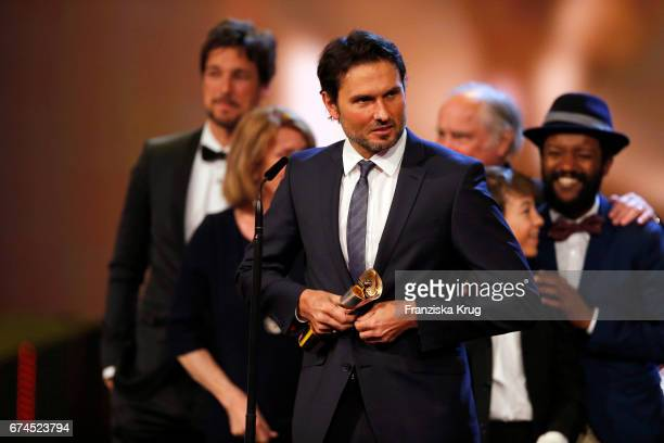 Simon Verhoeven after receiving his award for Largest Audience for the film Willkommen bei den Hartmanns at the Lola German Film Award show at Messe...
