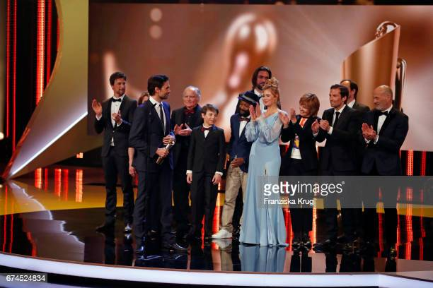 Simon Verhoeven on stage with cast and crew after receiving his award for Largest Audience for the film Willkommen bei den Hartmanns at the Lola...
