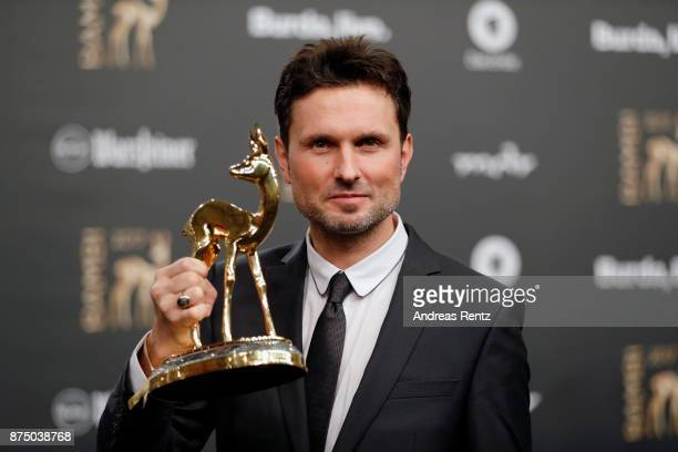 Simon Verhoeven poses with his award at the Bambi Awards 2017 winners board at Stage Theater on November 16 2017 in Berlin Germany