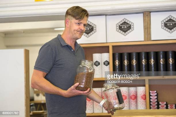 Simon Von Witt the founder of the Woodstock Gin Company holds a jar of rooibos tea which is used to flavour some of the gins on January 26 2017 in...