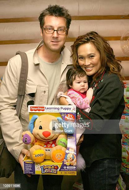 Simon Wakelin Tia Carrere and Bianca at Fisher Price