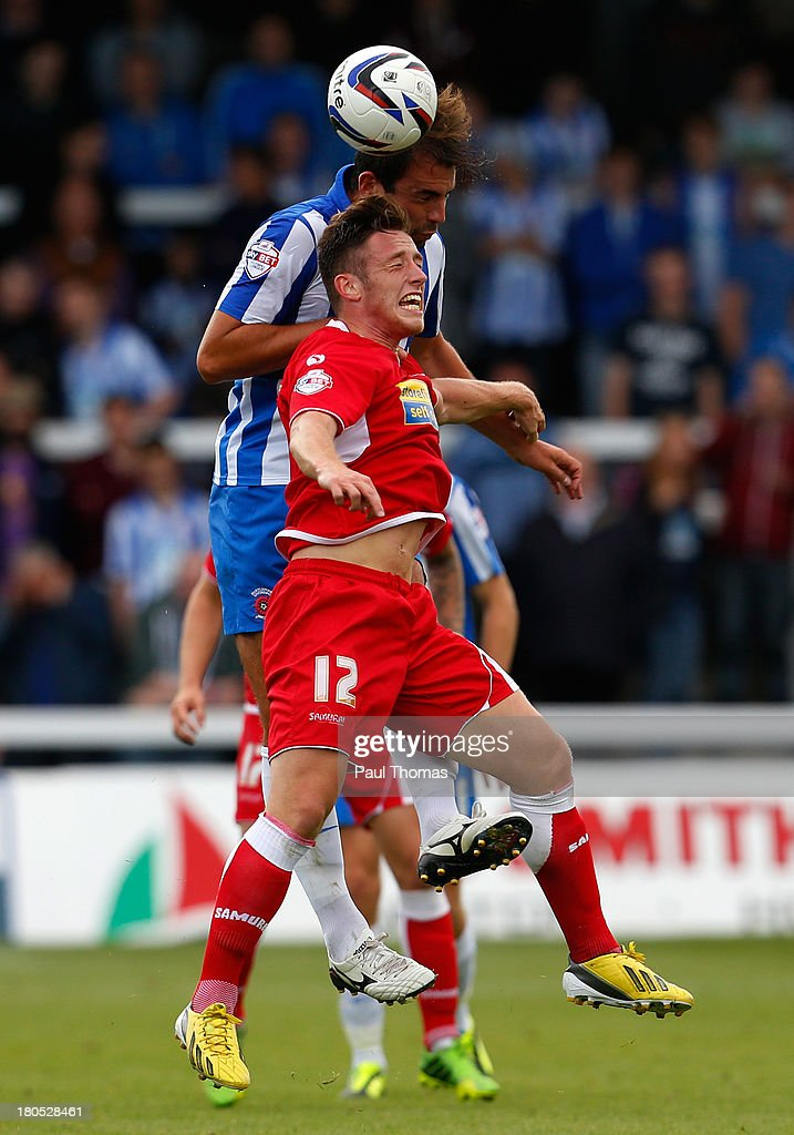 Simon Walton (L) of Hartlepool in action with George Miller of Accrington during the Sky Bet League Two match between Hartlepool United and Accrington Stanley at Victoria Park on September 14, 2013 in Hartlepool, England.