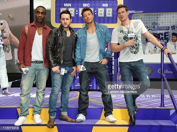 Simon Webbe Anthony Costa Duncan James and Lee Ryan of Boyband Blue compete to break a Guinness World Record for the fastest toilet roller at...