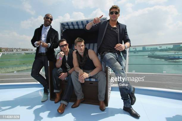 Simon Webbe Anthony Costa Lee Ryan and Duncan James of the band Blue from the United Kingdom pose in a beach chair while sailing on a ship on the...