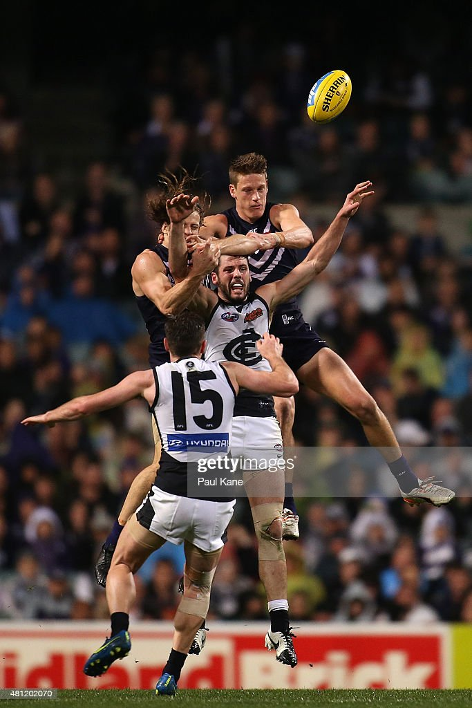 Simon White of the Blues contests a mark against Nathan Fyfe and Matt Taberner of the Dockers during the round 16 AFL match between the Fremantle Dockers and the Carlton Blues at Domain Stadium on July 18, 2015 in Perth, Australia.