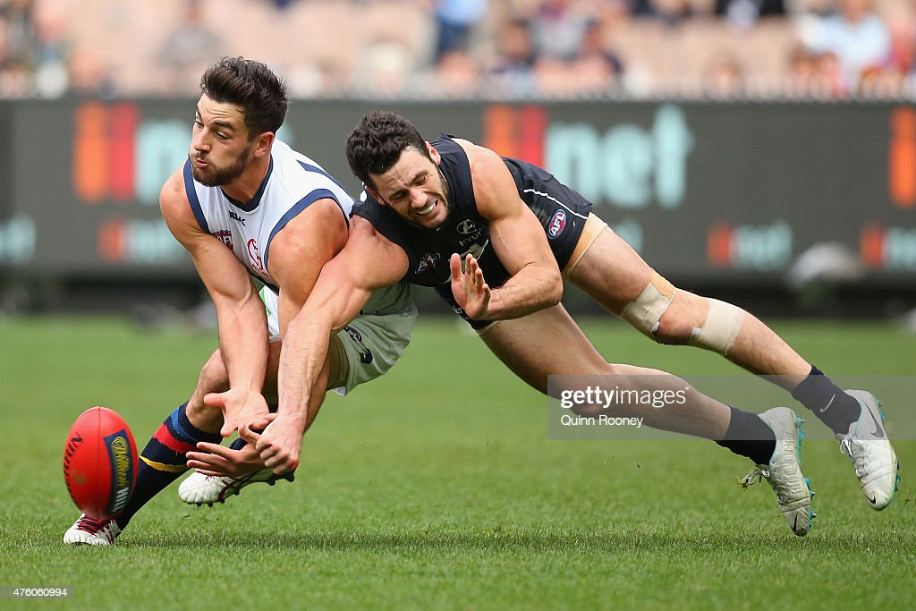 Simon White of the Blues spoils a mark by Taylor Walker of the Crows during the round 10 AFL match between the Carlton Blues and the Adelaide Crows at Melbourne Cricket Ground on June 6, 2015 in Melbourne, Australia.