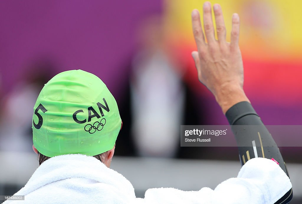 Simon Whitfield waves to his family before the swim, he would withdraw from the race after a crash during the first cycling lap the men's triathlon at the London 2012 Olympic Games at the Hyde Park.