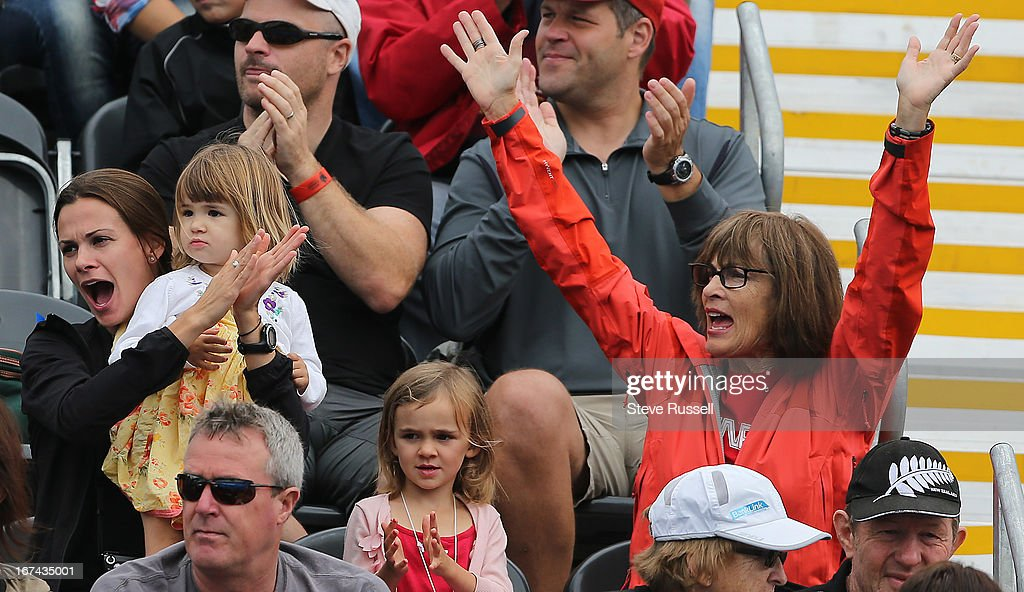 Simon Whitfield's wife and children cheer as he is introduced, he would withdraw from the race after a crash during the first cycling lap the men's triathlon at the London 2012 Olympic Games at the Hyde Park.