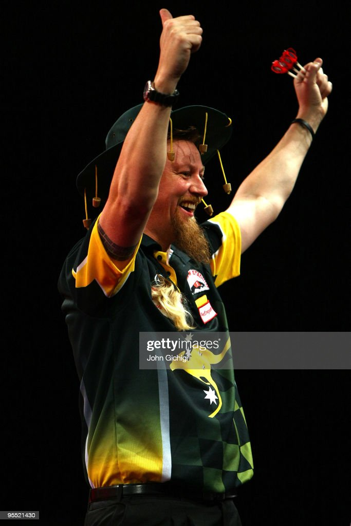 Simon Whitlock of Australia celebrates his win against James Wade of England during the Quarter Finals of the 2010 Ladbrokes.com World Darts Championships at Alexandra Palace on January 1, 2010 in London, England.