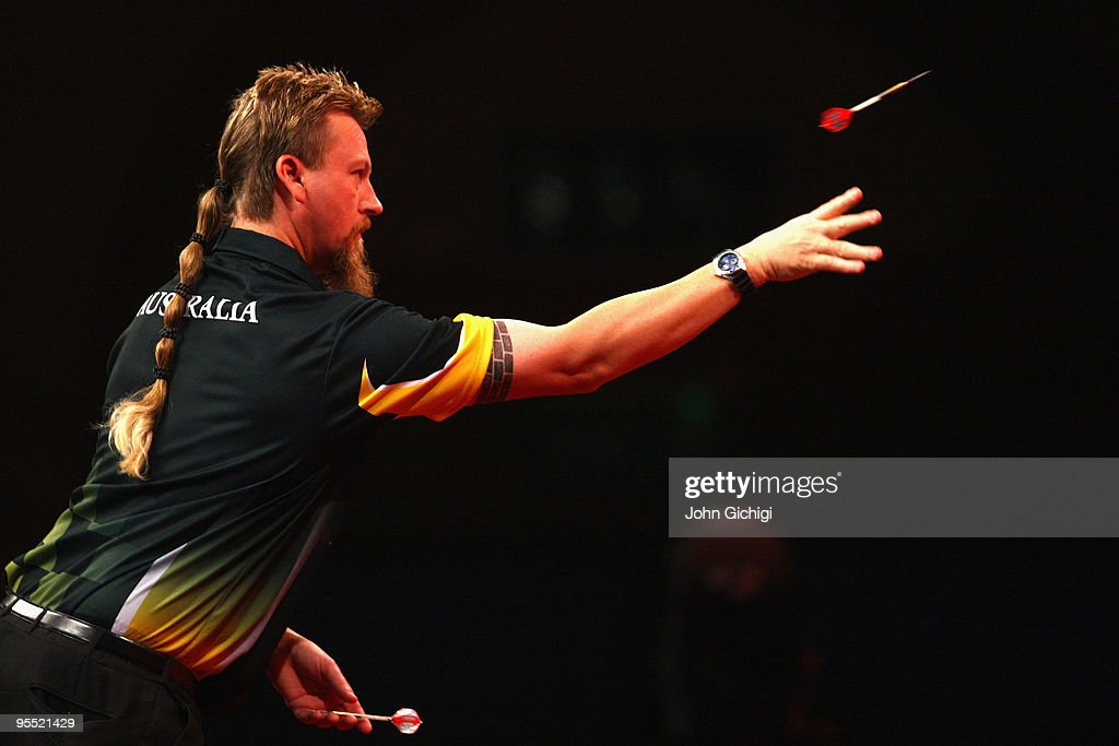 Simon Whitlock of Australia in action against James Wade of England during the Quarter Finals of the 2010 Ladbrokes.com World Darts Championships at Alexandra Palace on January 1, 2010 in London, England.