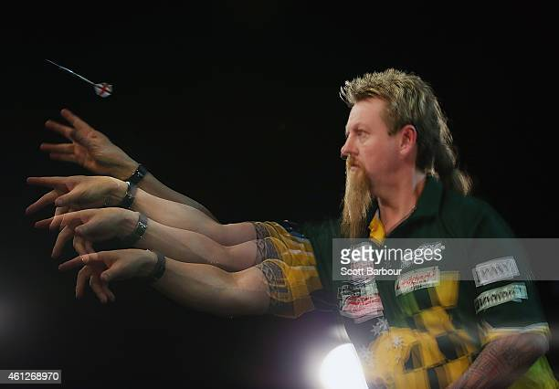 Simon Whitlock of Australia in action during the final between Simon The Wizard Whitlock and Mighty Michael van Gerwen during the Invitational Darts...