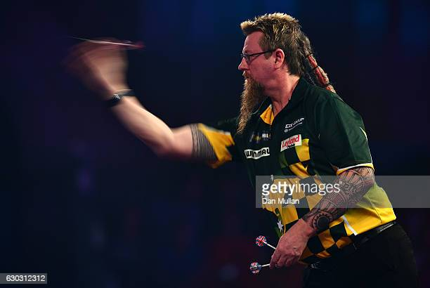 Simon Whitlock of Australia throws during the first round match against Dragutin Horvat of Germany on day six of the 2017 William Hill PDC World...