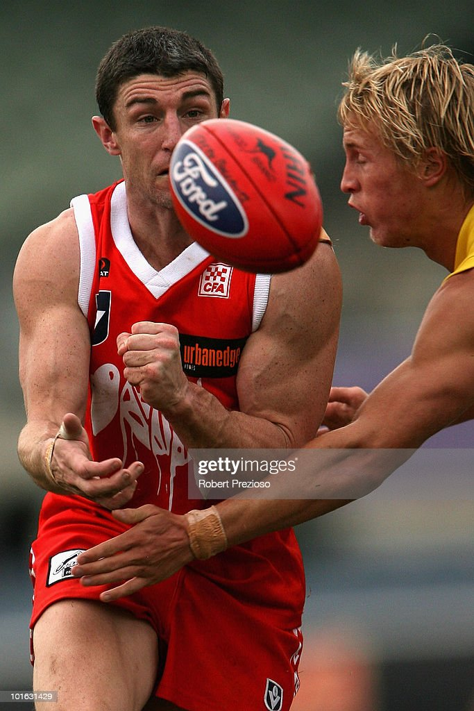 Simon Wiggins of the Bullants handballs under pressure during the round eight VFL match between the Bullants and the Gold Coast on June 5, 2010 in Melbourne, Australia.