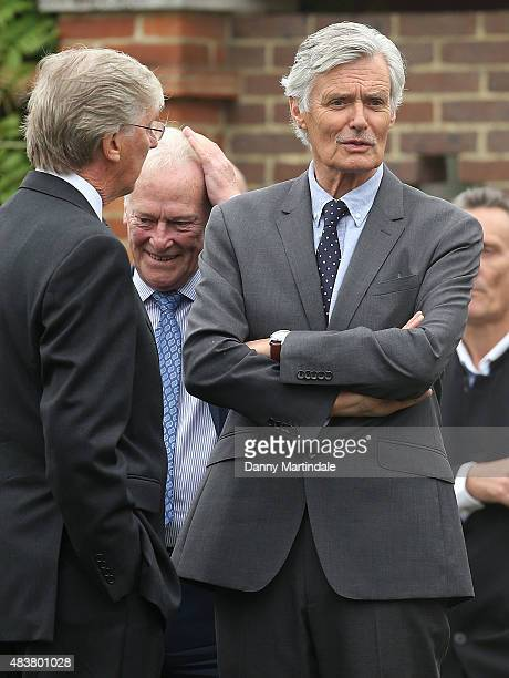 Simon Williams and Dennis Waterman attend the funeral of George Cole at Reading Crematorium on August 13 2015 in Reading England