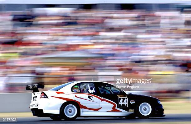 Simon Wills of the Team Dynamic Holden Commodore in action during the Big Pond 300 which is round 7 of the 2003 V8 Supercars Championship Series at...