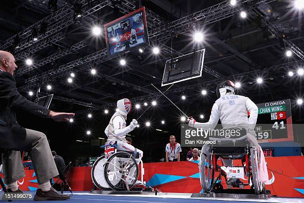 Simon Wilson of Great Britain competes against Wing Kin Chan of Hong Kong China during the Men's Team Catagory Open Wheelchair Fencing quarterfinal...