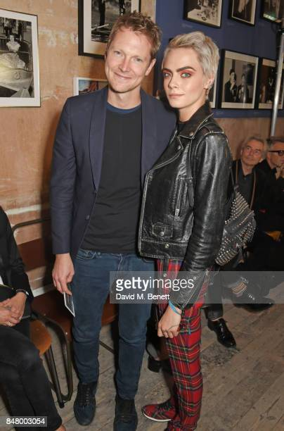 Simon Woods and Cara Delevingne wearing Burberry at the Burberry September 2017 at London Fashion Week at The Old Sessions House on September 16 2017...