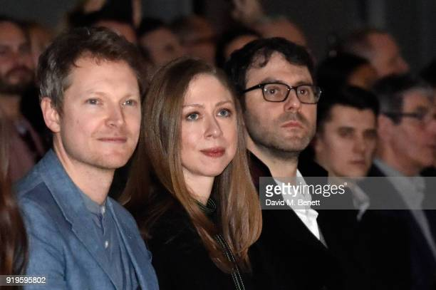 Simon Woods Chelsea Clinton and Marc Mezvinsky wearing Burberry at the Burberry February 2018 show during London Fashion Week at Dimco Buildings on...