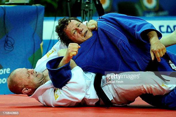 Simon Woods of Great Britain attempts to strangle Guenter Biskup of Germany during their M6 u81kgs contest which was eventually won by Biskup during...