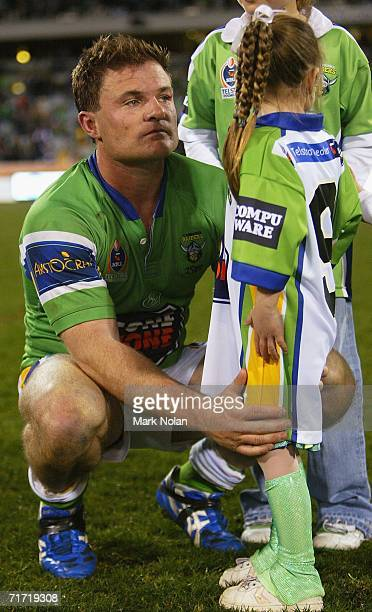 Simon Woolford of the Raiders with his daughter after the round 25 NRL match between the Canberra Raiders and the Melbourne Storm at Canberra Stadium...