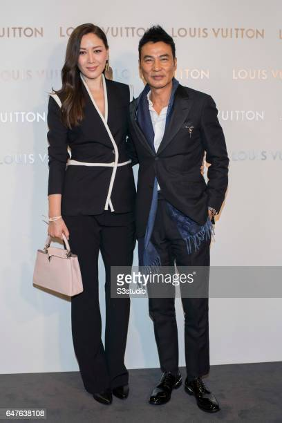 Simon Yam and his wife Sophia Kao known as 'Qi Qi' poses at the red carpet during the Louis Vuitton Landmark Maison opening on 02 March 2017, in...