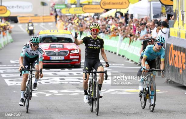 Simon Yates of Great Britain and Mitchelton-Scott celebrates winning in front of Peleo Bilbao Lopez De Armentia of Spain and Astana Pro Team and...