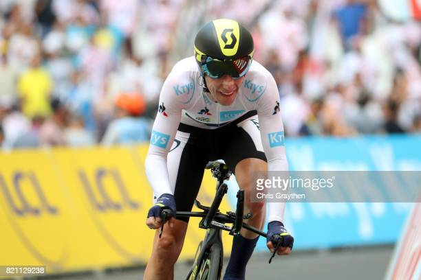 Simon Yates of Great Britain riding for Orica Scott in the best young rider jersey sprints to the finish during the individual time trial stage 20 of...