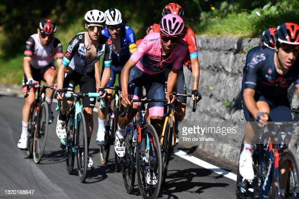 Simon Yates of United Kingdom and Team BikeExchange & Egan Arley Bernal Gomez of Colombia and Team INEOS Grenadiers Pink Leader Jersey during the...