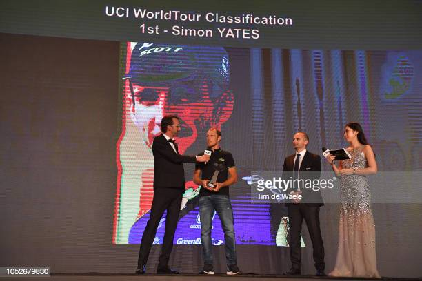 Simon Yates of United Kingdom and Team MitcheltonScott 1st UCI World Tour Classification / Prize receiving by Matteo Trentin of Italy and Team...