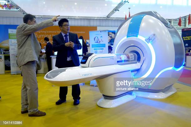 Simon Yeung presents a potential investor his invention a magnetic resonance tomography machine for babies at the 44th international inventors fair...